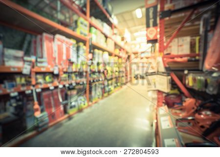 Blurred abstract selection of garden tools on rack shelves at hardware store in America. Defocused background variety of trimmer, blower, chain saws, hedge trimmer for gardening works poster