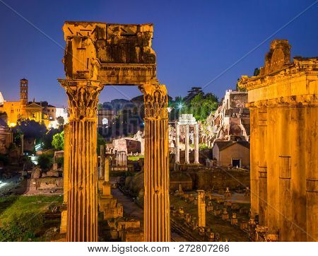 Night View Of Roman Forum In Rome, Italy. Rome Ancient Architect