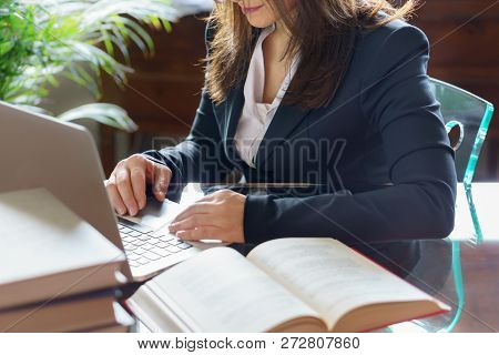Business Woman Working On A Laptop In Office