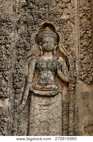 Old Buddhist Carving On A Natural Porous Cream Coloured Stone Wall