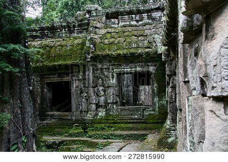 Windows In Ancient Moss Covered Ruins In The Jungles Of Cambodia