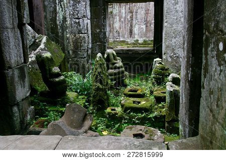 Looking Into A Small Moss Covered Room In Ruins In The Jungles Of Cambodia