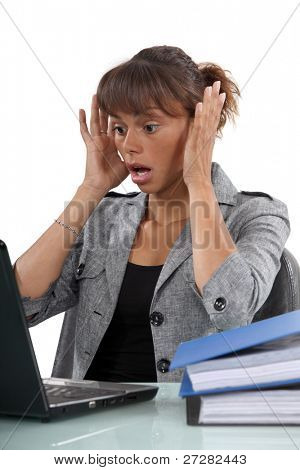 Distressed woman with laptop