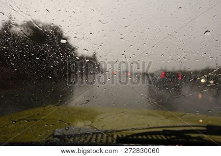 Deluge Of Rain In A Sudden Strom Whilst Driving On The Motorway.  Heavy Rain On The Windscreen.