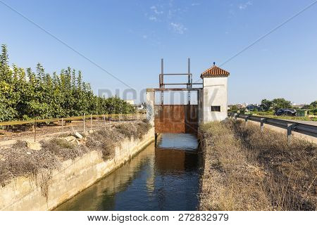 Sluicegate Of An Irrigation Watercourse Canal At Benifaio, Province Of Valencia, Spain