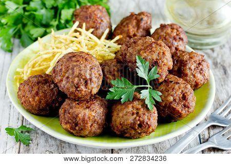Turkish Meatballs Kuru Kofte Garnished With Fried Potato Straws