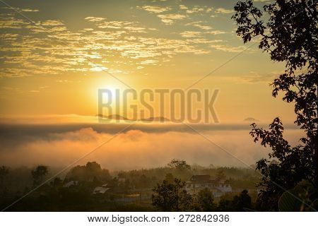 Winter Sunrise / Beautiful Morning With Fog Sunrise Over Misty On Meadow And In Village