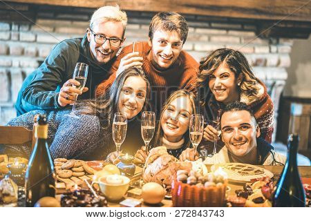 Happy Friends On Group Photo Selfie Celebrating Christmas Time With Champagne And Sweets Food At Din