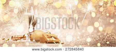 New Years Eve Celebration Background with Champagne and Fireworks. Golden Holiday Party