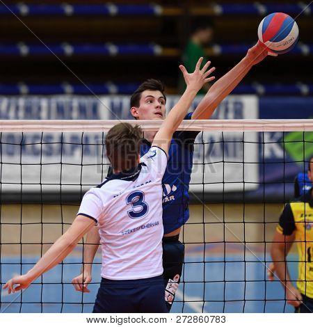 KAPOSVAR, HUNGARY – NOVEMBER 29, 2018: Akos Kalmar in blue in action at a Hungarian National Cup volleyball game between Kaposvar (blue) and MAV Elore (white) in Sportcsarnok Kaposvar.