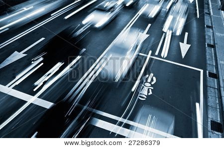 Traffic rush time with cars motion blurred in modern city.