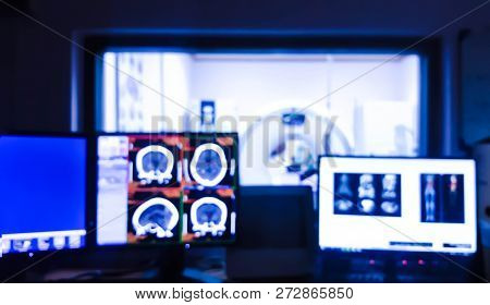 Blurred background of  Computed tomography ( CT scan ) room  with control workstation and monitors. poster