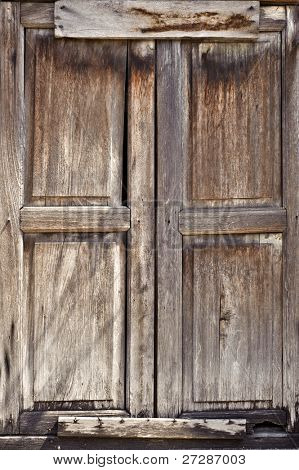 Old door of wooden was closed with grungy style.
