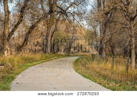 bike trail in late fall scenery along the Poudre River in northern Colorado
