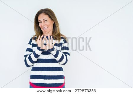 Beautiful middle age woman wearing navy sweater over isolated background disgusted expression, displeased and fearful doing disgust face because aversion reaction. With hands raised. Annoying concept.