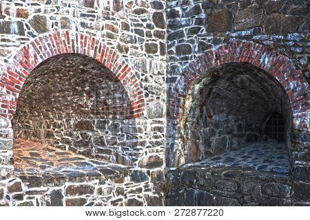 Embrasure In The Stone Wall Of An Ancient Fortress. Background Texture Of Ancient Historical Fortres