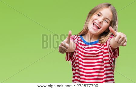 Young beautiful girl over isolated background approving doing positive gesture with hand, thumbs up smiling and happy for success. Looking at the camera, winner gesture.