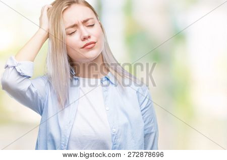 Young blonde woman over isolated background confuse and wonder about question. Uncertain with doubt, thinking with hand on head. Pensive concept.
