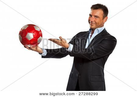 one caucasian business man holding showing soccer ball in studio isolated on white background