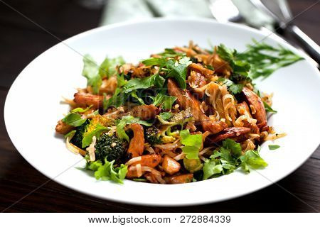 Rice Noodles With Chicken, Mushrooms Mun And Vegetables, Prepared In Plate. Top View.