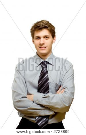 Handsome Young Businessman With Arms Crossed
