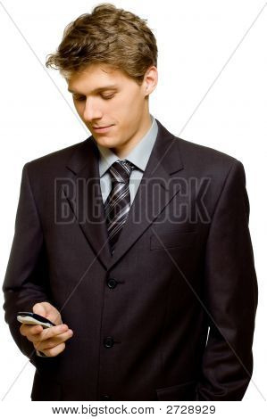 Young Handsome Businessman Reading A Text Message
