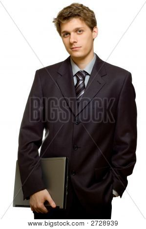 Handsome Businessman Holding A Laptop In One Hand The Other Is In His Pocket