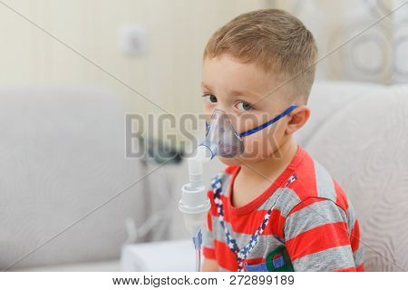 Caucasian Boy Inhales Couples Containing Medication To Stop Coughing.