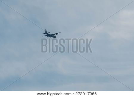 Chungju, South Korea; December 02, 2018; Military C130 Four Engine Turboprop Aircraft Flying In Part