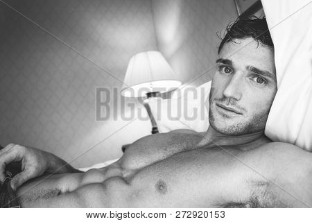 Black And White Portrait Of Sexy Shirtless Man With Pecs And Six Pack Abs Looking At Camera