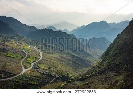 Panoramic View Over Valley With One Road And A Small Village In Vietnam