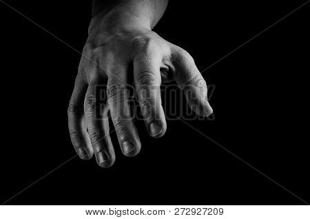 Hand Reaching Isolated On Black Background. Conceptual, Give Me Your Hand, Helping Hand Concept.