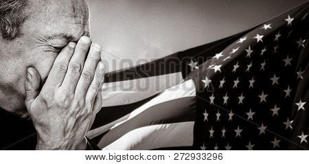 Veteran. Patriotic Concept. Portrait Of An Elderly Man With Face Closed By Hand On Usa Flag Backgrou