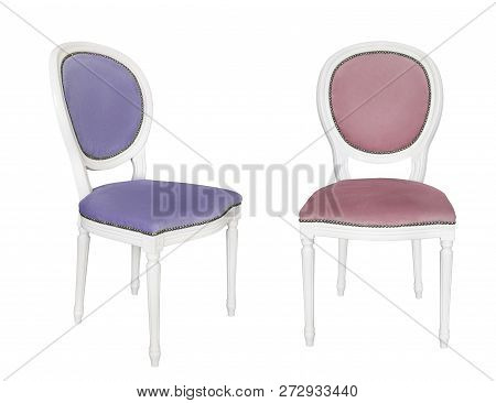 An Antique White Chairs With A Blue Upholstery Isolated On Black Background. Retro Style. Furniture