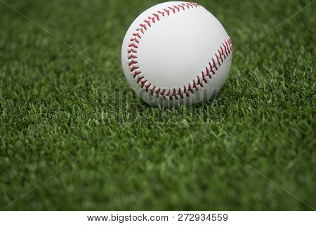 This Is An Image Of Baseball On Green Grass