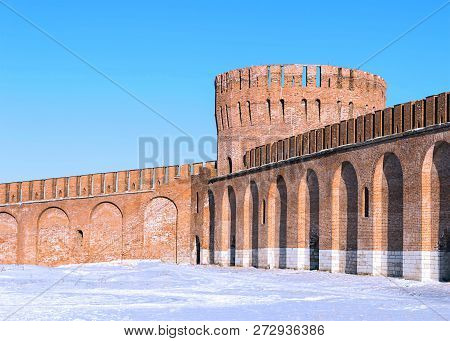Brick Round Big Tower High With A Crenellated Wall With Arches Protective Wall Of The Kremlin Agains