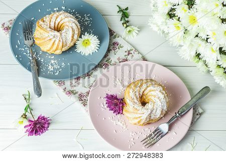 Delicious Cakes With Coconut Chips On Pink And Gray Plate On White Table, Autumn Chrysanthemum. Fami