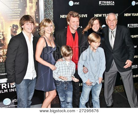 NEW YORK, NY - DECEMBER 07: Jon Bon Jovi with family and producer Garry Marshall  poses for a photo during the 'New Year's Eve' premiere at Ziegfeld Theatre on December 7, 2011 in New York City.