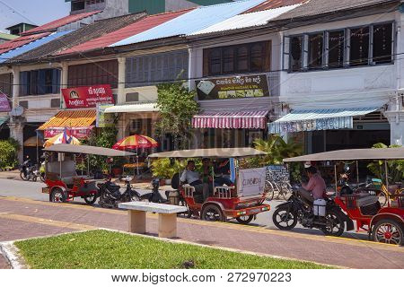 Kampot, Cambodia - 12 April 2018: Town View With French Colonial Buildings And Khmer People Daily Li