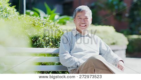 Old Man Smile To You And Sit On A Chair In The Park