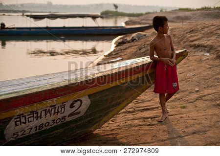 Champasak, Laos - February 26 : Unidentified Kid Of Laos Stand In Long Tail Boat On February 26, 201
