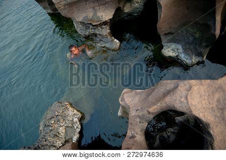 Sampanbok Ubonratchathani - February 26 : Activities On The Mekong River, Children Swimming And Play