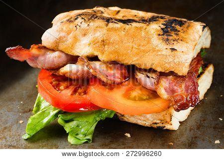 Close Up Of Rustic Bacon Lettuce Tomato Blt Sandwich