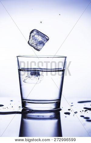 Splash Ice Cubes In A Water Glass