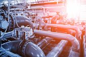 Pipes and sewage pumps inside modern industrial wastewater treatment plant. poster