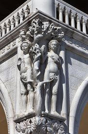 Sculpture Of Adam And Eva In The Corner Of Doge's Palace In Venice.