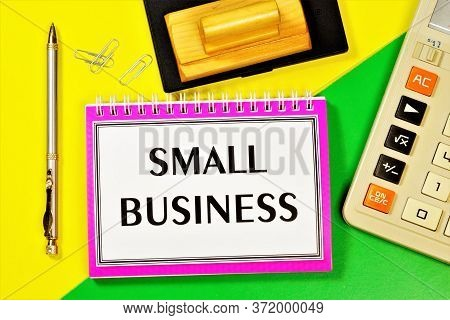 Small Business-entrepreneurship Of Small Firms. On The Table Is A Calculator, A Commerce Planning No