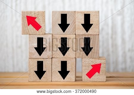 Wood Cube Presents Red Arrow Facing Opposite Direction, Concept Of Think Different, Leadership Minds