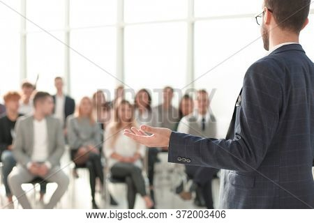close up. speaker standing in front of the audience in the conference room