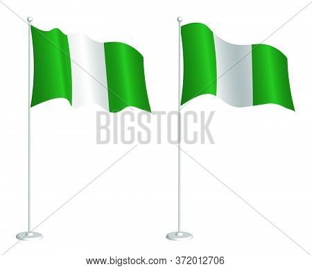 Flag Of Federal Republic Of Nigeria On Flagpole Waving In The Wind. Holiday Design Element. Checkpoi